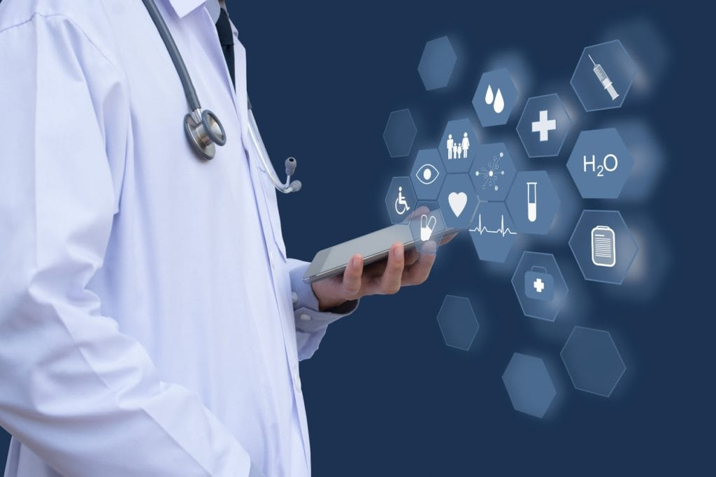 Medical technology concept, doctor hand working on digital tablet computer with health icons flow on virtual screen, e health service or telemedicine concept.